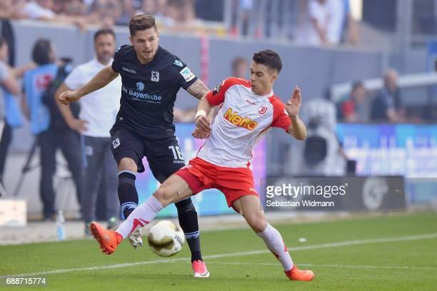 Erik Thommy of Jahn Regensburg challenges Marnon Busch of 1860 Muenchen during the Second Bundesliga Playoff first leg match between Jahn Regensburg...