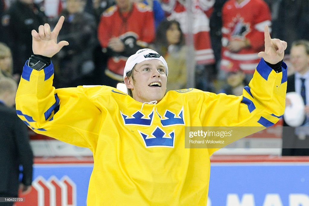 Erik Thorell #28 of Team Sweden celebrates after defeating Team Russia during the 2012 World Junior Hockey Championship Gold Medal game at the Scotiabank Saddledome on January 5, 2012 in Calgary, Alberta, Canada. Team Sweden defeated Team Russia 1-0 in overtime.