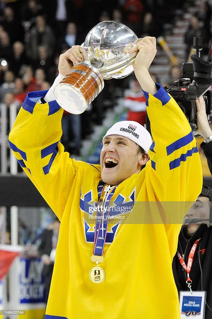 Erik Thorell #28 of Team Sweden hoists the championship cup after defeating Team Russia during the 2012 World Junior Hockey Championship Gold Medal game at the Scotiabank Saddledome on January 5, 2012 in Calgary, Alberta, Canada. Team Sweden defeated Team Russia 1-0 in overtime.
