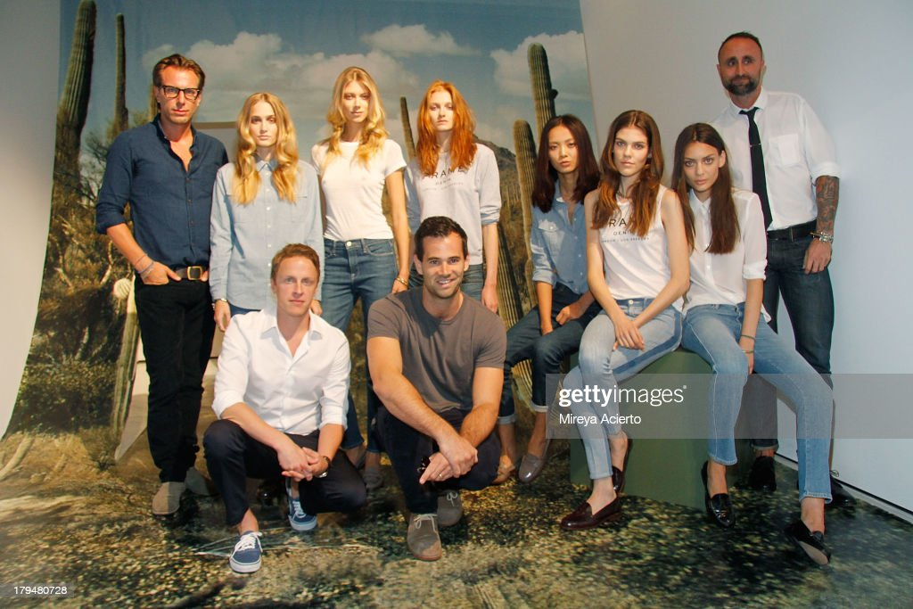 Erik Torstensson, Josh LeVine, Jens Grede and Nico Peyrache pose with models at the Frame Denim presentation during Mercedes-Benz Fashion Week Spring 2014 at Openhouse Gallery on September 4, 2013 in New York City.
