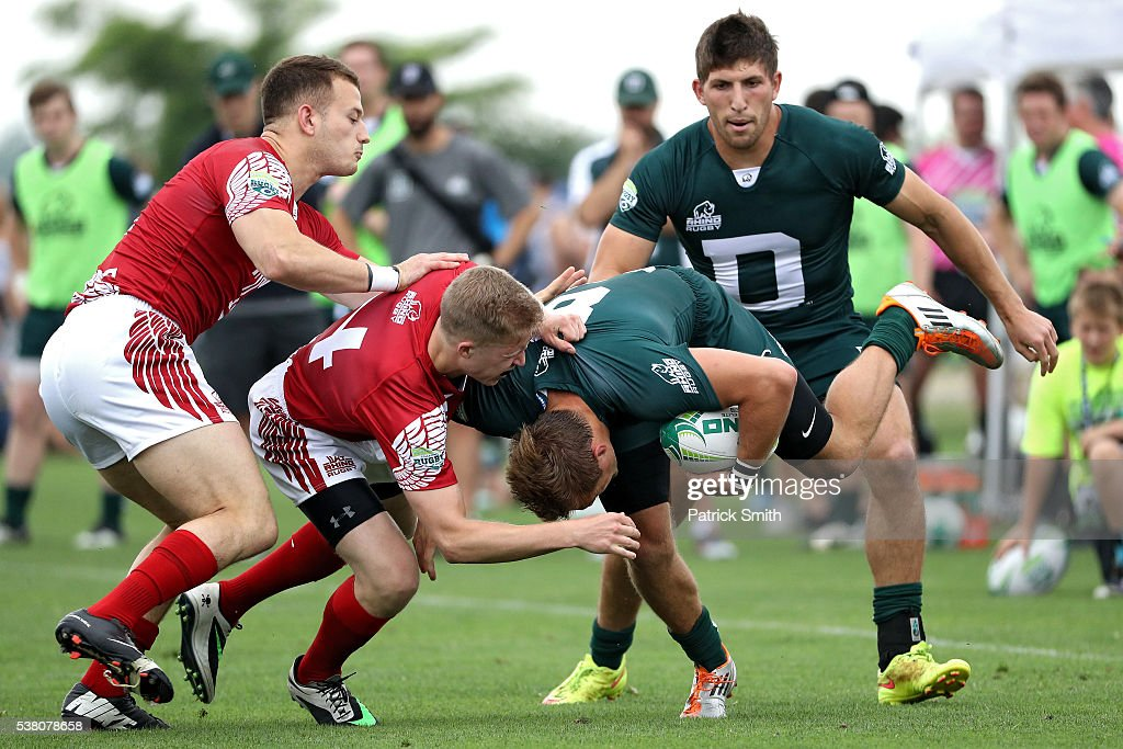 Erik Warnquist of Dartmouth College is tackled by Thomas Jenkins of Temple during Day 1 of the Penn Mutual Collegiate Rugby Championships at Talen...