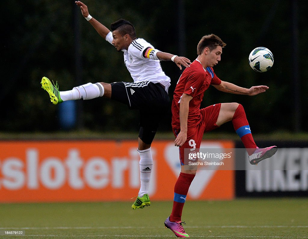 Erik Zenga of Germany and Lukas Stratil of Czech Republic battle for the ball during the U20 juniors tournament match between the Czech Republic and Germany on October 14, 2013 in Gemert, Netherlands.