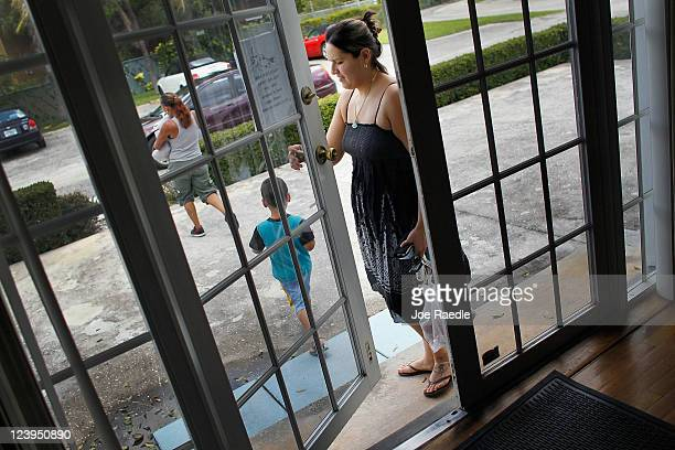 Erika Astudillo leaves a bag of dog food from Fido's Food Bank at the Peggy Adams Animal Rescue League September 6 2011 in Palm Beach Florida As the...