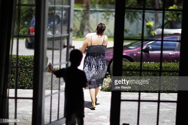 Erika Astudillo walks to her car with a bag of dog food from Fido's Food Bank at the Peggy Adams Animal Rescue League on September 6 2011 in Palm...