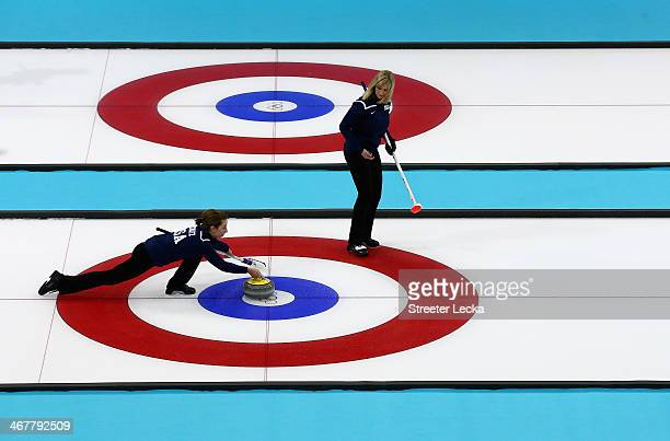 Erika Brown of the USA watches teammate Jessica Hultz during curling training on day 1 of the Sochi 2014 Winter Olympics at the Ice Cube on February...