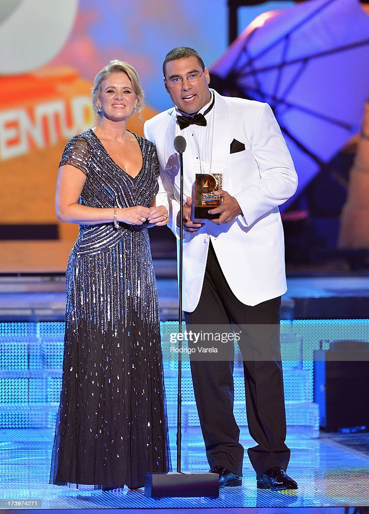 Erika Buenfil and Eduardo Yanez speak onstage during the Premios Juventud 2013 at Bank United Center on July 18, 2013 in Miami, Florida.