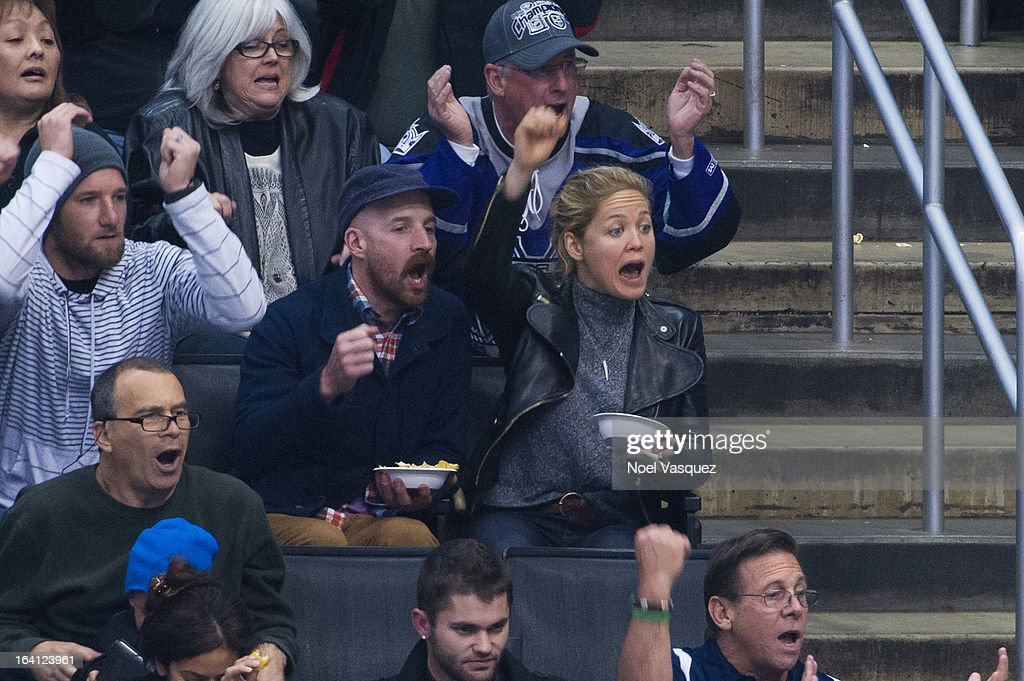 <a gi-track='captionPersonalityLinkClicked' href=/galleries/search?phrase=Erika+Christensen&family=editorial&specificpeople=202168 ng-click='$event.stopPropagation()'>Erika Christensen</a> (R) and Cole Maness attend a hockey game between the Phoenix Coyotes and Los Angeles Kings at Staples Center on March 19, 2013 in Los Angeles, California.