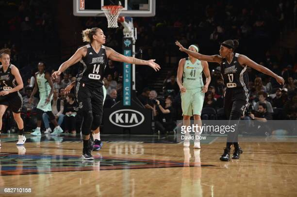 Erika de Souza and Sequoia Holmes of the San Antonio Stars high five against the New York Liberty at Madison Square Garden on May 13 2017 in New York...