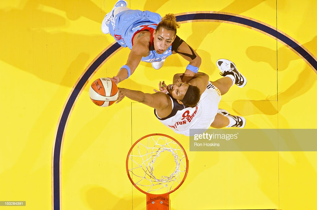 Erika de Souza #14 of the Atlanta Dream attempts a shot against <a gi-track='captionPersonalityLinkClicked' href=/galleries/search?phrase=Tammy+Sutton-Brown&family=editorial&specificpeople=208212 ng-click='$event.stopPropagation()'>Tammy Sutton-Brown</a> #8 of the Indiana Fever during Game Three of the Eastern Conference Semifinals at Bankers Life Fieldhouse on October 2, 2012 in Indianapolis, Indiana.