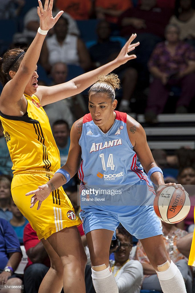 Erika de Souza #14 of the Atlanta Dream drives against Elizabeth Cambage #8 of the Tulsa Shock during the WNBA game on July 21, 2013 at the BOK Center in Tulsa, Oklahoma.