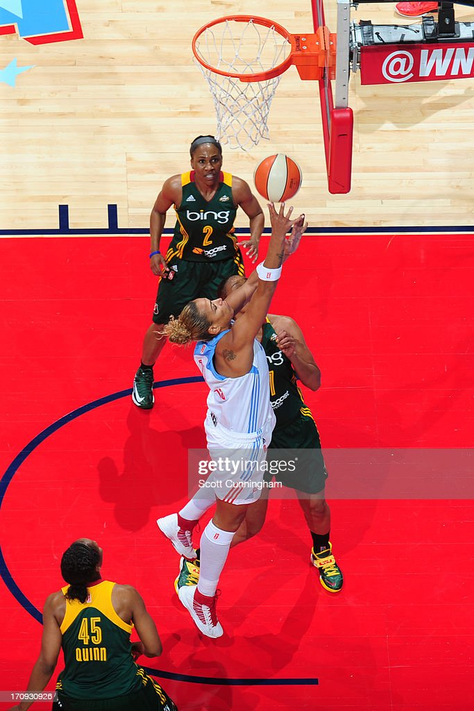 Erika de Souza #14 of the Atlanta Dream drives to the basket against the Seattle Storm at Philips Arena on June 14, 2013 in Atlanta, Georgia.