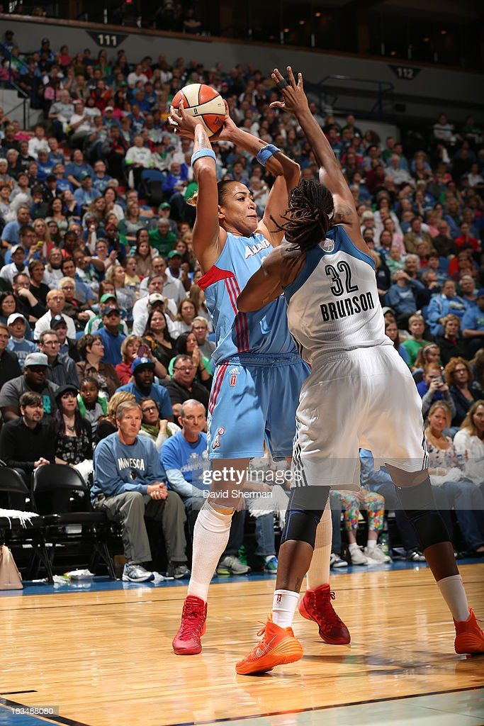 Erika de Souza #14 of the Atlanta Dream looks to pass the ball against <a gi-track='captionPersonalityLinkClicked' href=/galleries/search?phrase=Rebekkah+Brunson&family=editorial&specificpeople=213521 ng-click='$event.stopPropagation()'>Rebekkah Brunson</a> #32 of the Minnesota Lynx during Game 1 of the 2013 WNBA Finals on October 6, 2013 at Target Center in Minneapolis, Minnesota.