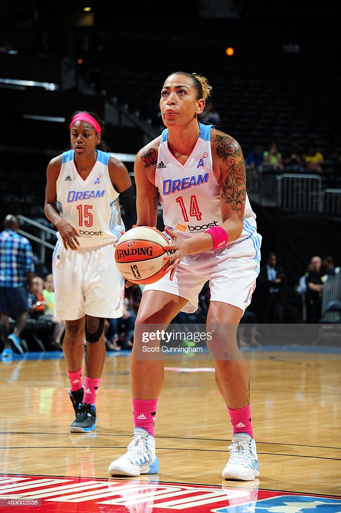 Erika de Souza #14 of the Atlanta Dream shoots a free throw against the Connecticut Sun on July 29, 2014 at Philips Arena in Atlanta, Georgia.