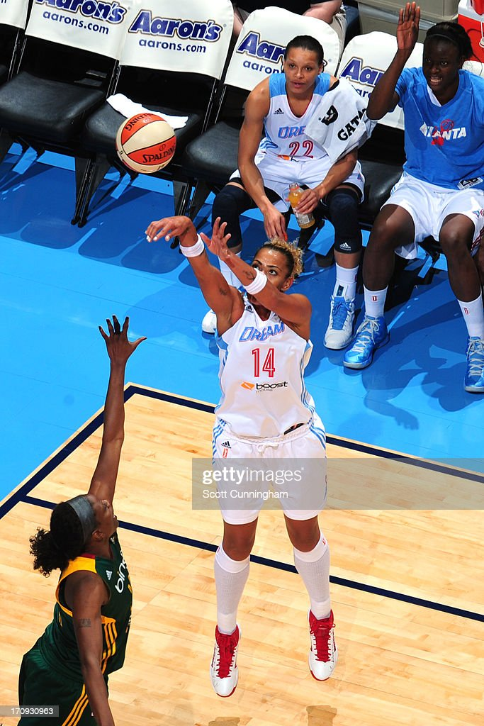 Erika de Souza #14 of the Atlanta Dream shoots the ball against the Seattle Storm at Philips Arena on June 14, 2013 in Atlanta, Georgia.