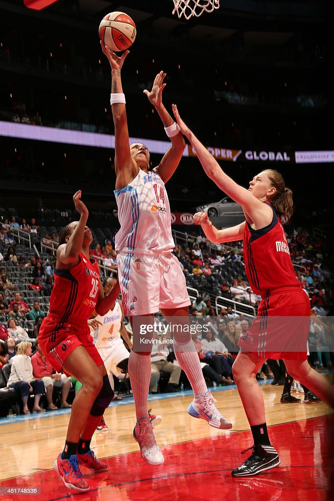 Erika de Souza #14 of the Atlanta Dream takes a shot against the Washington Mystics at Philips Arena on July 5, 2014 in Atlanta, Georgia.