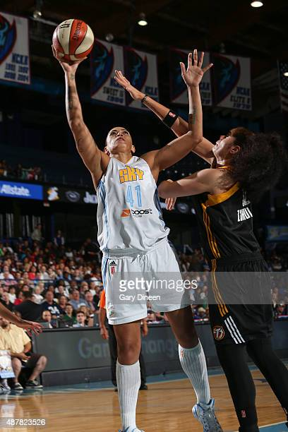 Erika De Souza of the Chicago Sky shoots against Amanda Zahui B #32 of the Tulsa Shock on September 11 2015 at the Allstate Arena in Rosemont...