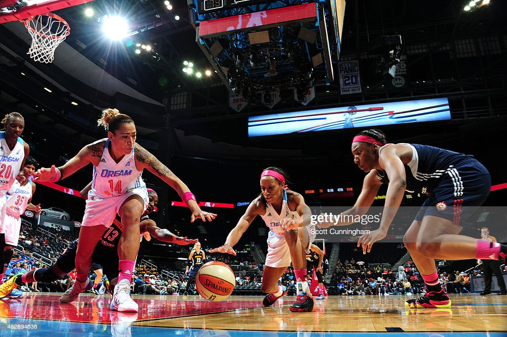 Erika deSouza #15 and Jasmine Thomas #5 of the Atlanta Dream battle for a loose ball against Kelsey Bone #14 of the Connecticut Sun on July 29, 2014 at Philips Arena in Atlanta, Georgia.