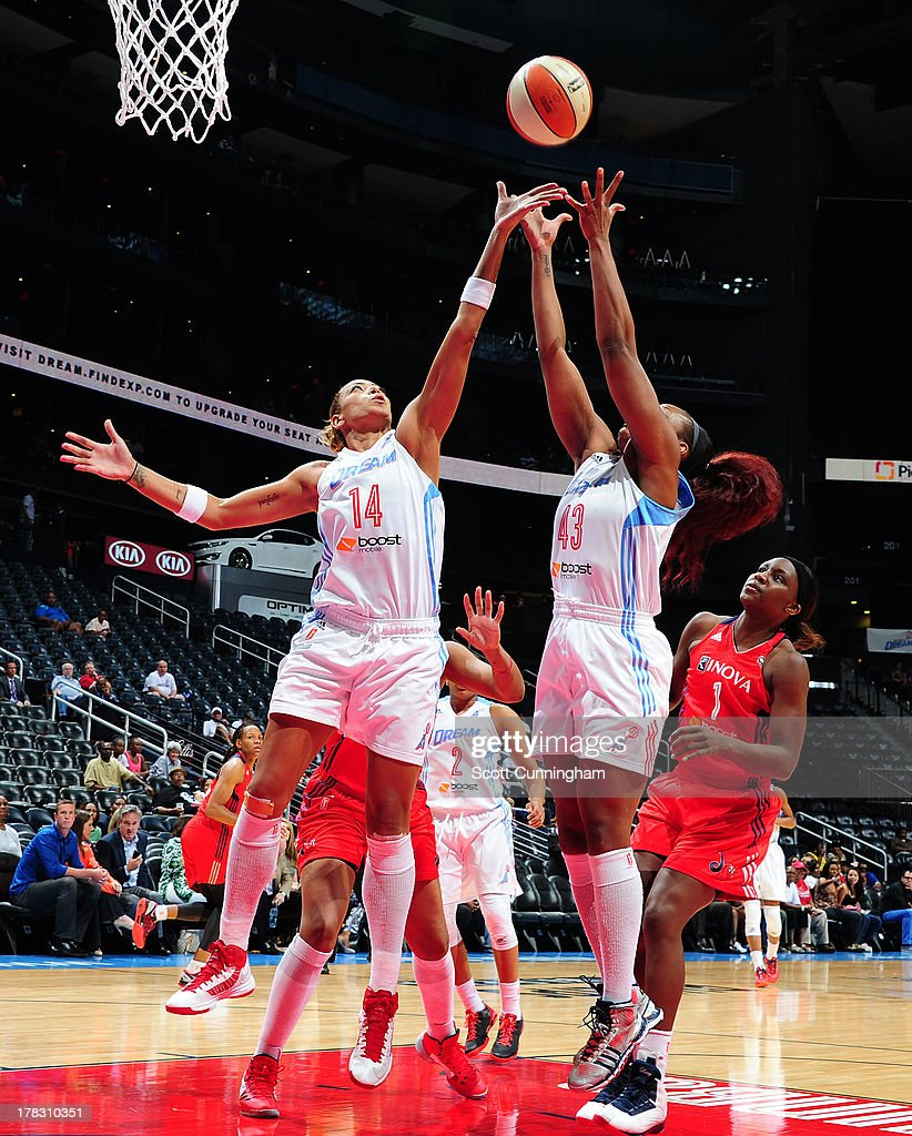 Erika deSouza #14 and Le 'Coe Willingham #43 of the Atlanta Dream go up for a rebound against the Washington Mystics at Philips Arena on August 28 2013 in Atlanta, Georgia.