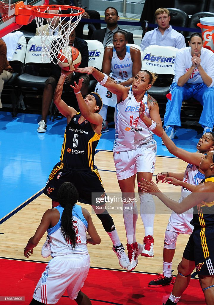 Erika deSouza #14 of the Atlanta Dream blocks a shot against <a gi-track='captionPersonalityLinkClicked' href=/galleries/search?phrase=Layshia+Clarendon&family=editorial&specificpeople=10666159 ng-click='$event.stopPropagation()'>Layshia Clarendon</a> #5 of the Indiana Fever at Philips Arena on September 4 2013 in Atlanta, Georgia.