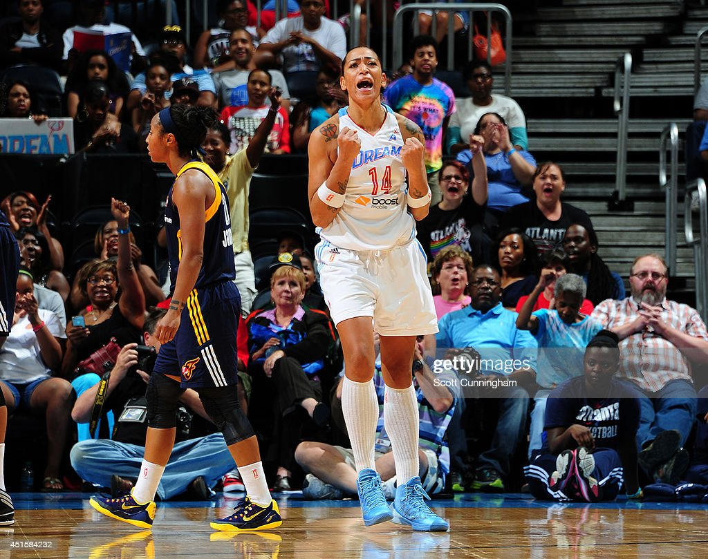 Erika deSouza #14 of the Atlanta Dream celebrates after scoring against the Indiana Fever on July 1, 2014 at Philips Arena in Atlanta, Georgia.