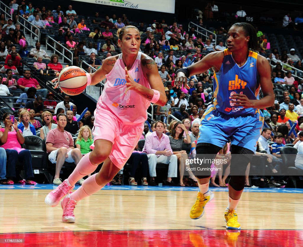 Erika deSouza #14 of the Atlanta Dream drives against <a gi-track='captionPersonalityLinkClicked' href=/galleries/search?phrase=Sylvia+Fowles&family=editorial&specificpeople=707903 ng-click='$event.stopPropagation()'>Sylvia Fowles</a> #34 of the Chicago Sky at Philips Arena on August 24 2013 in Atlanta, Georgia.