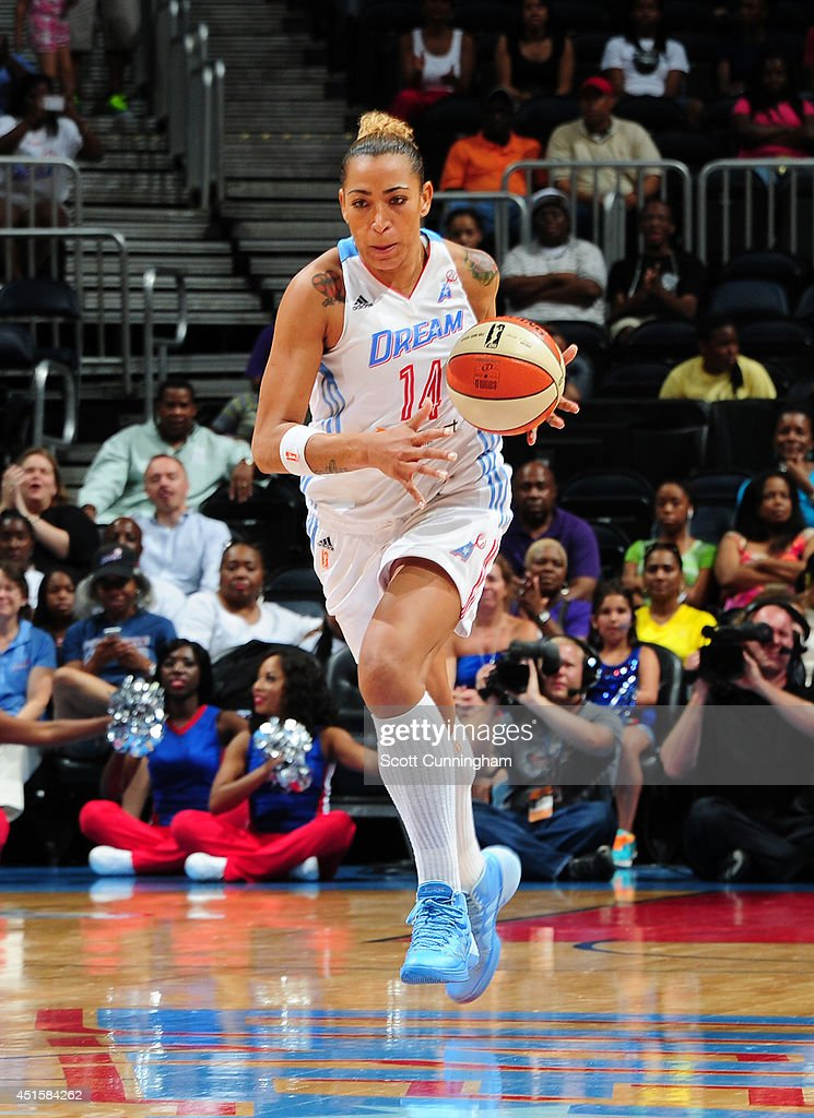 Erika deSouza #14 of the Atlanta Dream drives against the Indiana Fever on July 1, 2014 at Philips Arena in Atlanta, Georgia.