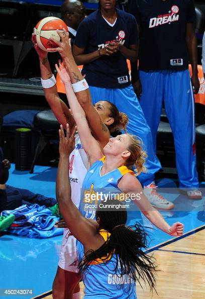 Erika deSouza of the Atlanta Dream grabs a rebound against Courtney Vandersloot of the Chicago Sky on June 7 2014 at Philips Arena in Atlanta Georgia...