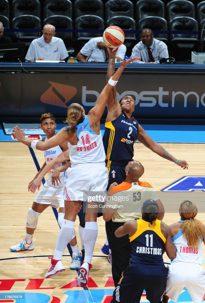 Erika deSouza #14 of the Atlanta Dream tips off against Erlana Larkins #2 #5 of the Indiana Fever at Philips Arena on September 4 2013 in Atlanta, Georgia.