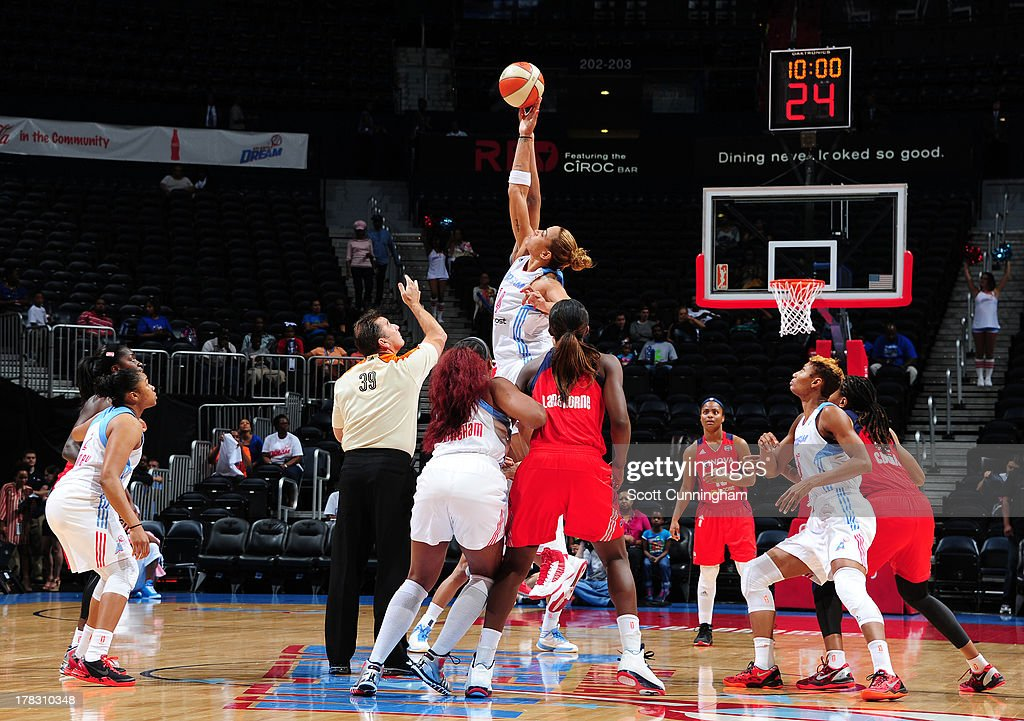 Erika deSouza #14 of the Atlanta Dream wins a tip against the Washington Mystics at Philips Arena on August 28 2013 in Atlanta, Georgia.