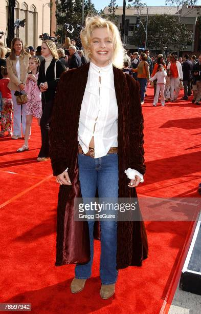 Erika Eleniak arrives on the red carpet for the 20th Anniversary Premiere of Steven Spielberg's 'ET' on March 16 2000 in Los Angeles California