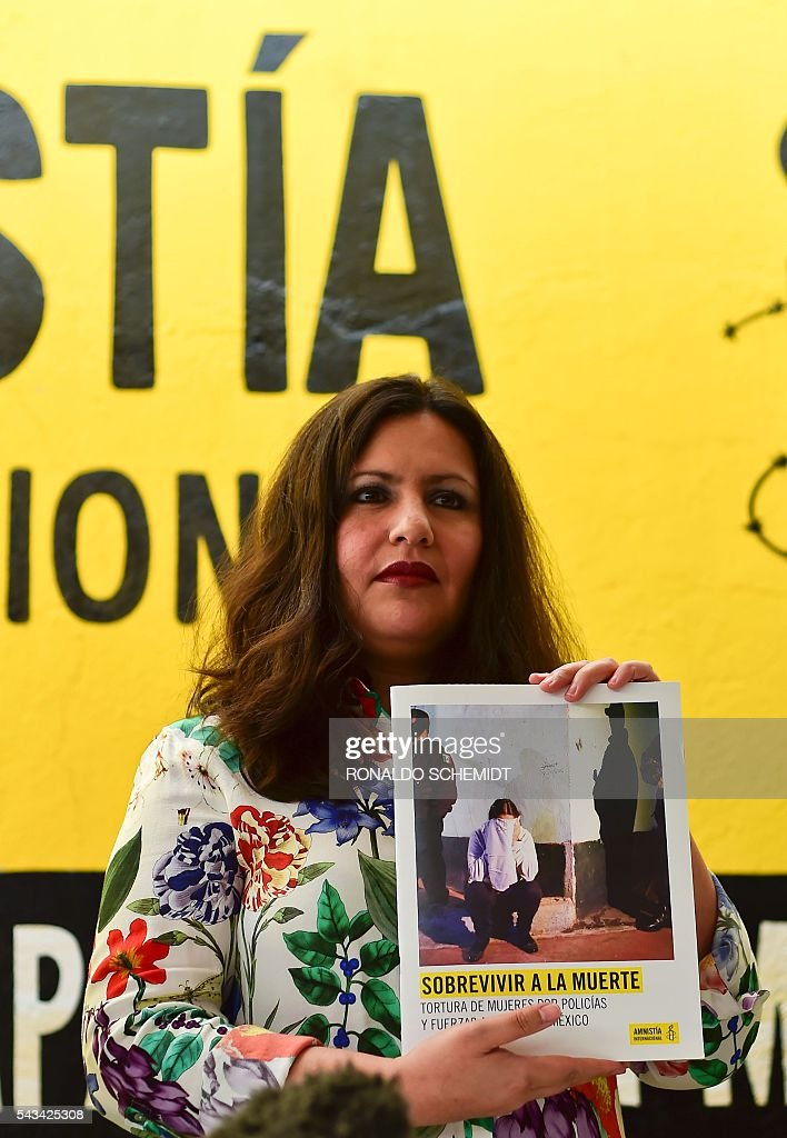 Erika Guevara-Rosas, director for the Americas of International Amnesty poses during the presentation of the report 'Survive to the death' on torture to women in jails of Mexico, on June 28, 2016, in Mexico city. / AFP / RONALDO