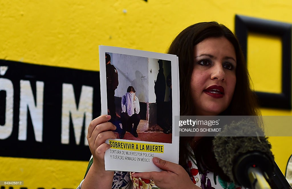 Erika Guevara-Rosas, director for the Americas of International Amnesty speaks during the presentation of the report 'Survive to the death' on torture to women in jails of Mexico, on June 28, 2016, in Mexico city. / AFP / RONALDO