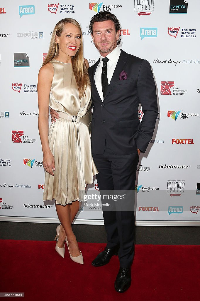 Erika Heynatz and Andrew Kingston arrive at the 2014 Helpmann Awards at the Capitol Theatre on August 18, 2014 in Sydney, Australia.