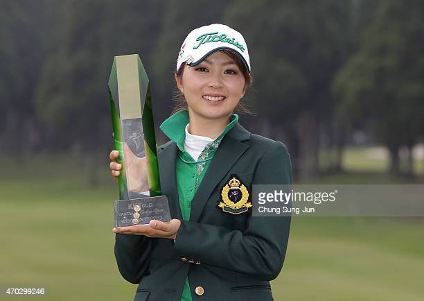 Erika Kikuchi of Japan lifts the winner's trophy during a ceremony following the KKT Cup Vantelin Ladies Open at the Kumamoto Airport Country Club on...
