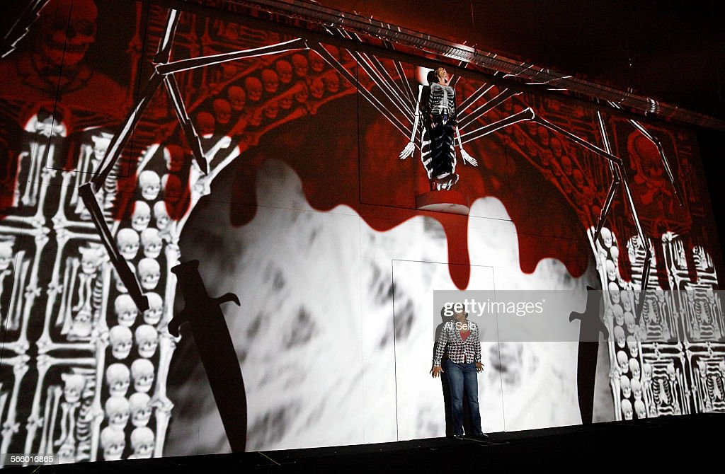 Erika Miklosa as The Queen of the Night character high on the projection wall rehearses with Janai Brugger as Pamina below during rehearsals for...