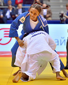 Erika Miranda of Brazil smiles broadly after defeating former World champion Yanet Bermoy Acosta of Cuba to win the u52kg bronze medal during the...