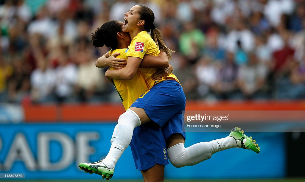Erika of Brazil celebrates scoring the first goal with Aline during the FIFA Women's World Cup 2011 Group D match between Equatorial Guinea and...