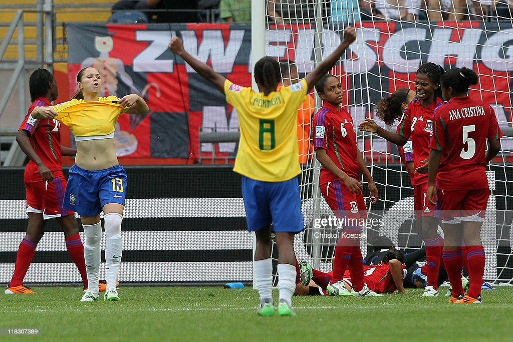 Erika of Brazil celebrates the first goal with Formiga of Brazil during the FIFA Women's World Cup 2011 Group D match between Equatorial Guinea and...