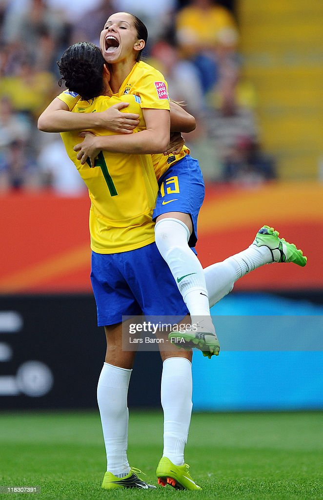 Erika of Brazil celebrates with Aline after scoring his teams first goal during the FIFA Women's World Cup 2011 Group D match between Equatorial...