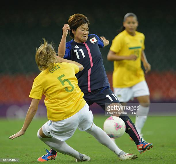 Erika of Brazil challenges for the ball with Aya Sameshima of Japan during the Women's Football Quarter Final match between Brazil and Japan on Day 7...