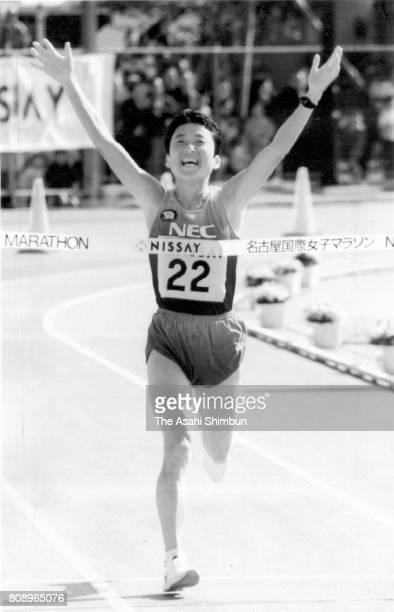 Eriko Asai of Japan crosses the finish tape to win the 15th Nagoya International Women's Marathon at Mizuho Athletic Stadium on March 13 1994 in...