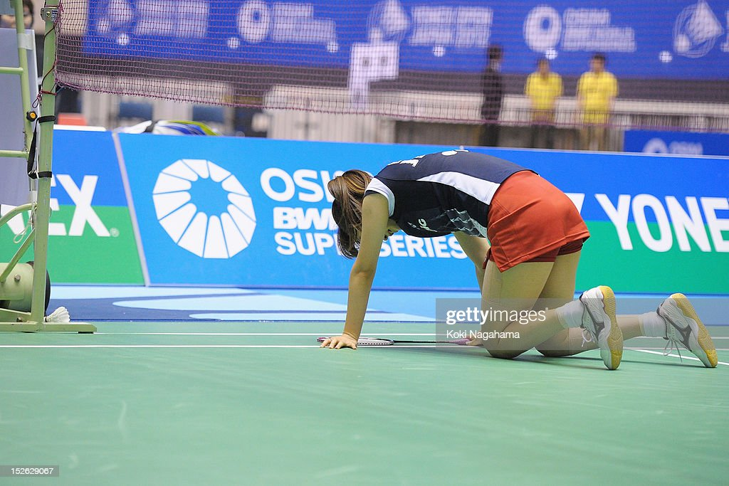 <a gi-track='captionPersonalityLinkClicked' href=/galleries/search?phrase=Eriko+Hirose&family=editorial&specificpeople=654988 ng-click='$event.stopPropagation()'>Eriko Hirose</a> of Japan looks dejected in the women's singles final match against Tzu Ying Tai of Taiwan during day five of the Yonex Open Japan 2012 at Yoyogi Gymnasium on September 23, 2012 in Tokyo, Japan.