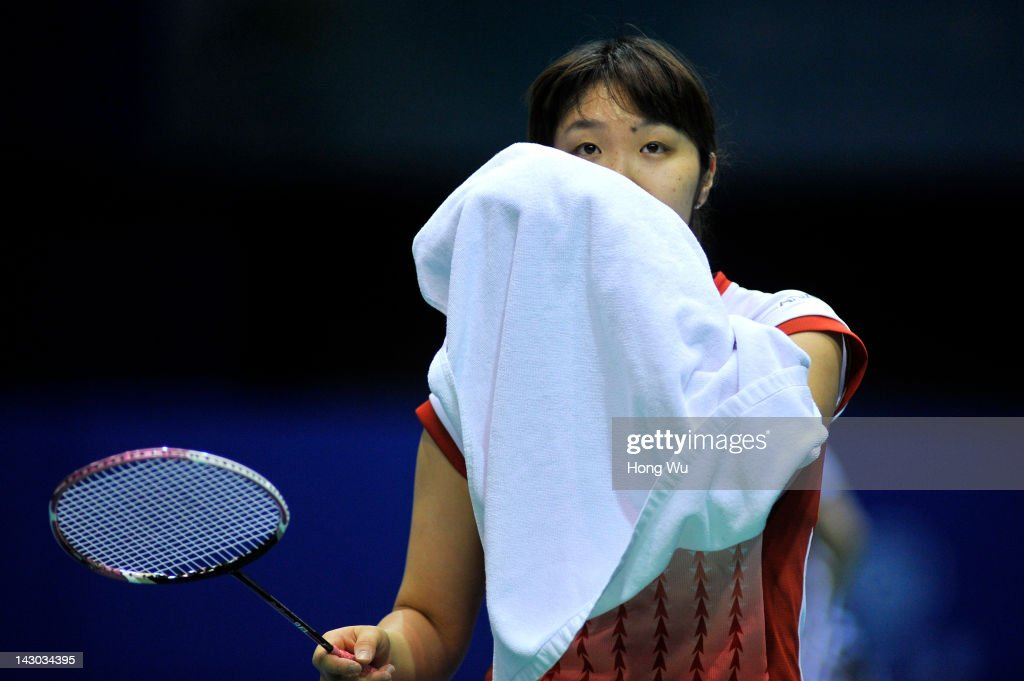 <a gi-track='captionPersonalityLinkClicked' href=/galleries/search?phrase=Eriko+Hirose&family=editorial&specificpeople=654988 ng-click='$event.stopPropagation()'>Eriko Hirose</a> of Japan wipes her face with a towel during her match against Wang Yihan of China during day Two of the 2012 Badminton Asia Championships at Qingdao Guoxin Gymnasium on April 18, 2012 in Qingdao, China.