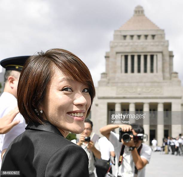 Eriko Imai a vocalist of the fourmember female group SPEED that became popular in the 1990s arrives at the parliament in Tokyo on Aug 1 as she marked...