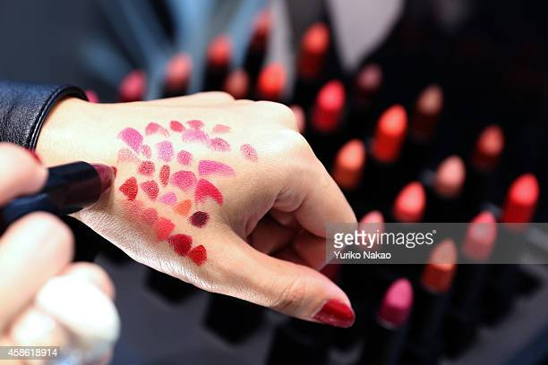 Eriko Takano tries out various colours of 'Audacious lipsticks' at NARS PopUp Boutique ahead of Francois Nars' signing event at RStudio of Omotesando...