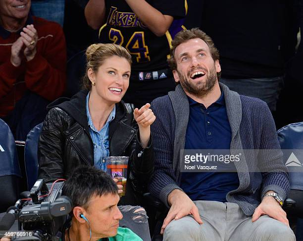 Erin Andrews and Jarret Stoll attend a basketball game between the Toronto Raptors and the Los Angeles Lakers at Staples Center on November 30 2014...