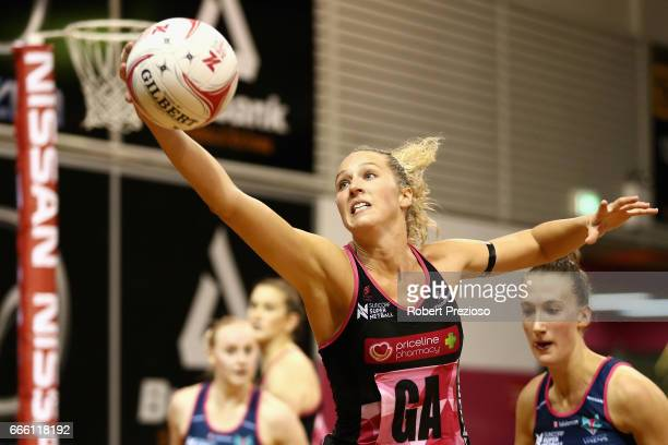 Erin Bell of the Thunderbirds gathers the ball during the round eight Super Netball match between the Thunderbirds and the Vixens at Priceline...