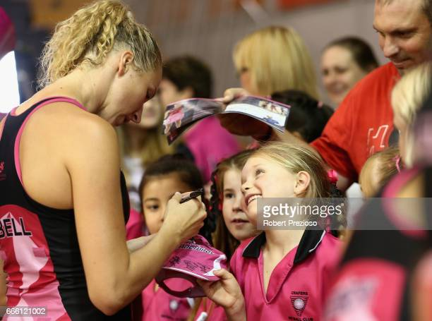 Erin Bell of the Thunderbirds signs autographs for fans during the round eight Super Netball match between the Thunderbirds and the Vixens at...