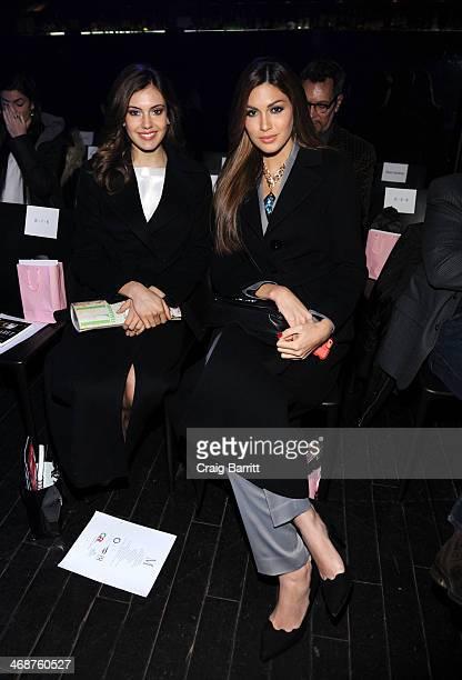 Erin Brady and Gabriela Isler attend the Malan Breton fashion show during MercedesBenz Fashion Week Fall 2014 at XL Nightclub on February 11 2014 in...