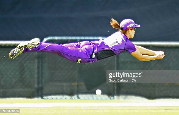 Erin Burns of the Hurricanes dives as she attempts to take a catch on the boundary during the Women's Big Bash League match between the Hobart...